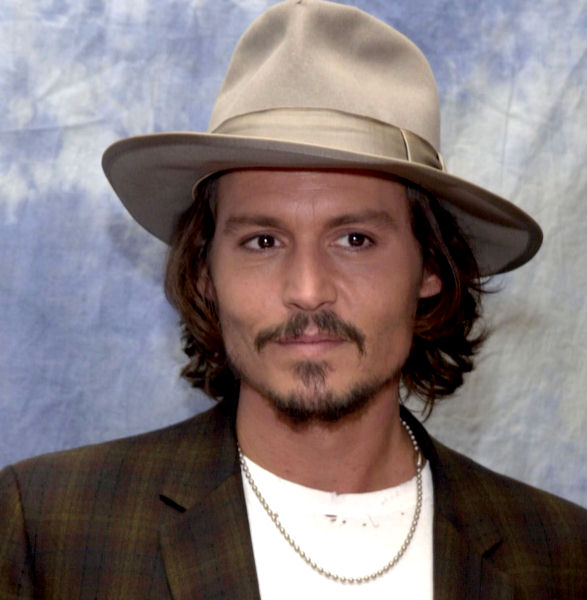 Johnny Depp at a press conference for Pirates Of The Caribbean: Dead Man's Chest at the Hotel Regent Beverly Wiltshire in Los Angeles - 22 June 2006 FAMOUS PICTURES AND FEATURES AGENCY 13 HARWOOD ROAD LONDON SW6 4QP UNITED KINGDOM tel +44 (0) 20 7731 9333 fax +44 (0) 20 7731 9330 e-mail info@famous.uk.com www.famous.uk.com FAM17913