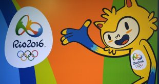 Picture of a billboard depicting the mascot of the Rio 2016 Olympic Games, taken before its presentation as well as thatfor the Rio 2016 Paralympic Games, in Rio de Janeiro, Brazil, on November 24, 2014. The Rio Olympic Games have their mascot, a yellow feline animal representing Brazil's rich fauna and wildlife, while the Paralympic Games mascot is a predominantly blue and green figure whose head of covered with leaves -- depicting once again the host country's rich vegetation as Brazil prepares to welcome the Olympics to South America for the first time. It remains only for the public to decide on a name, choosing from a range of options.  AFP PHOTO / YASUYOSHI CHIBAYASUYOSHI CHIBA/AFP/Getty Images ORG XMIT: