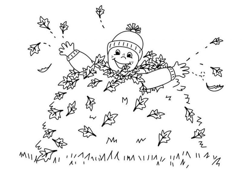 nino-jugando-hojas-otono